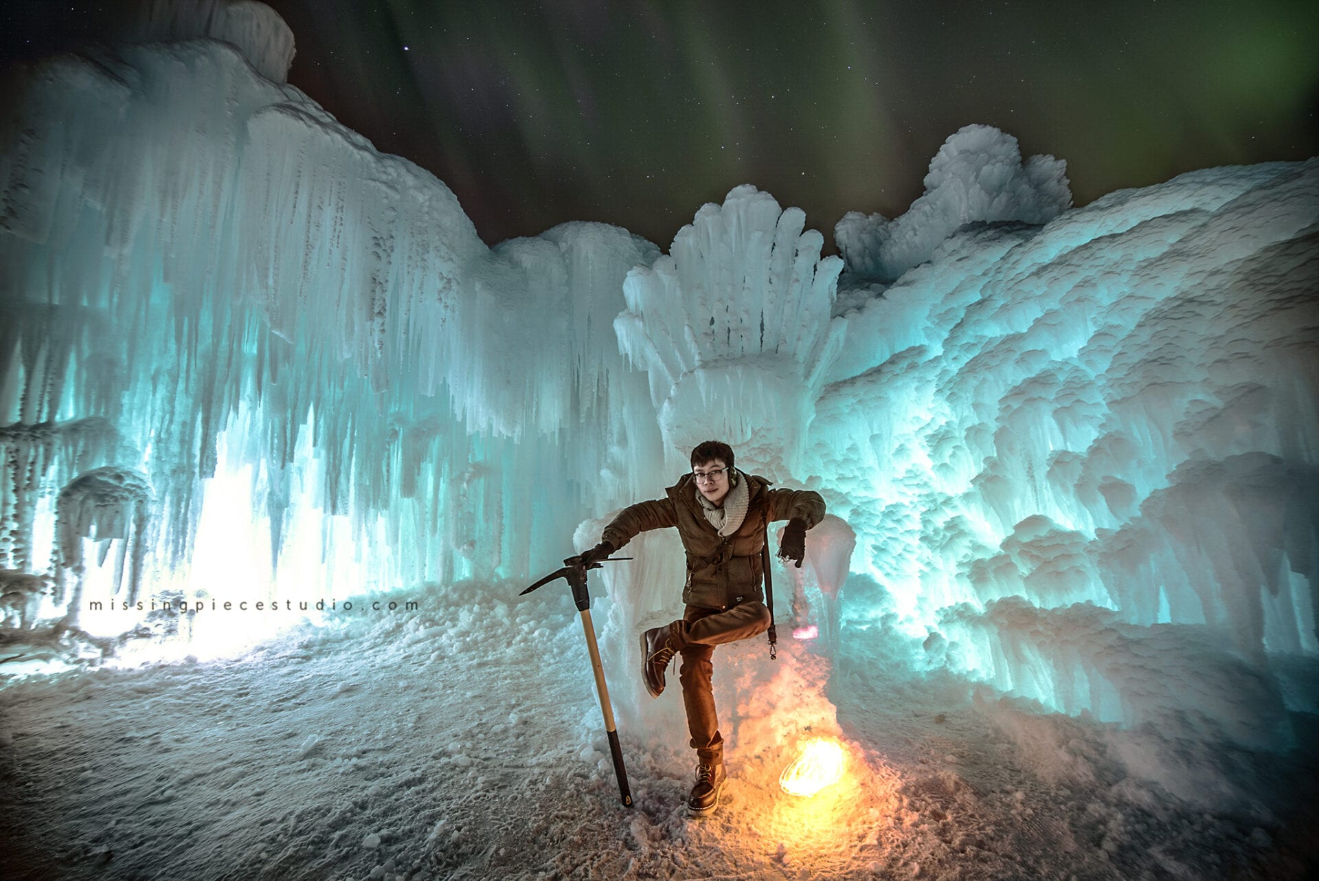 Photographer takes a photo of himself on the ice throne at the Edmonton Ice Castles