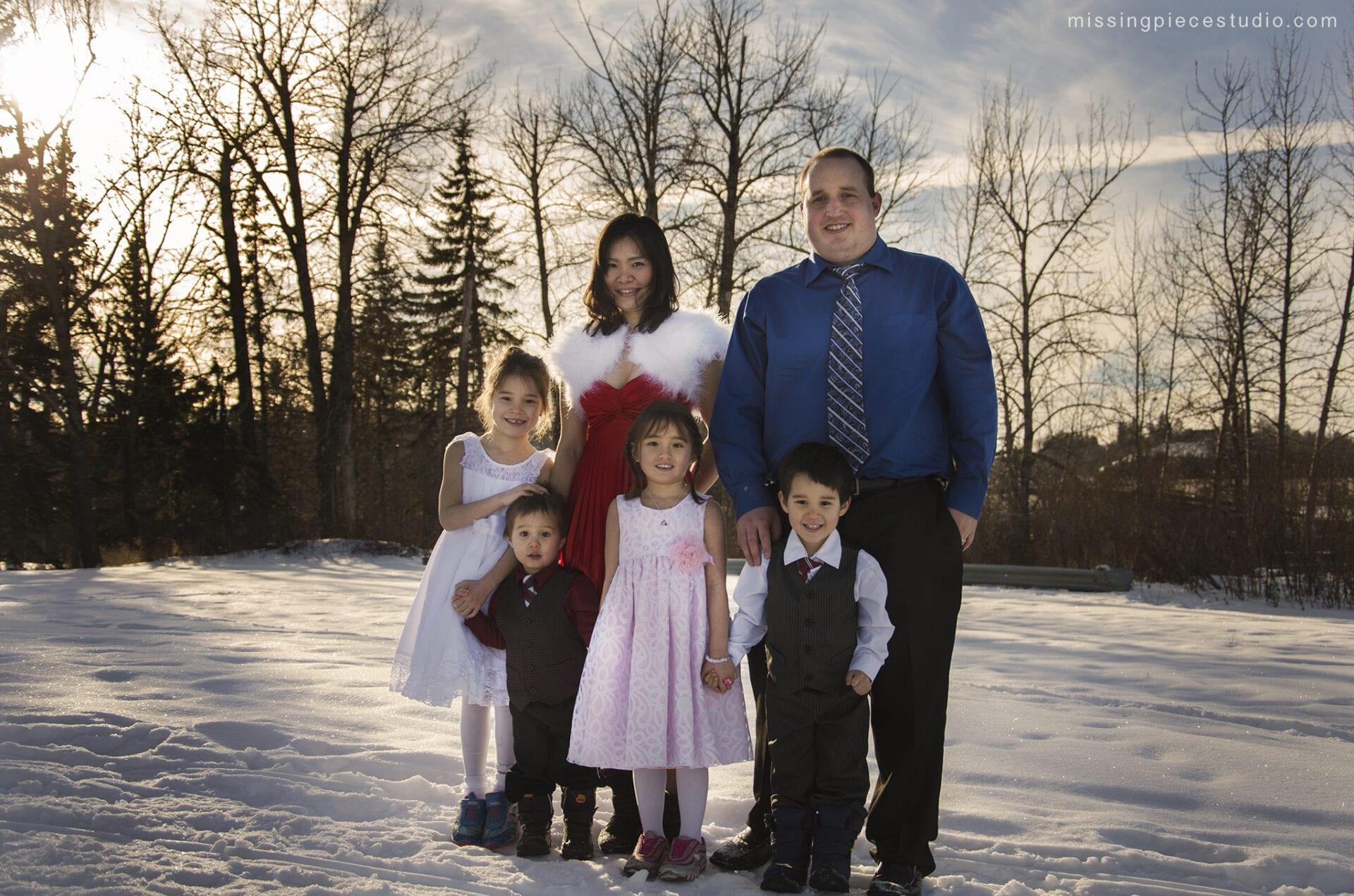 Winter family portrait session at Whitemud Park Bridge