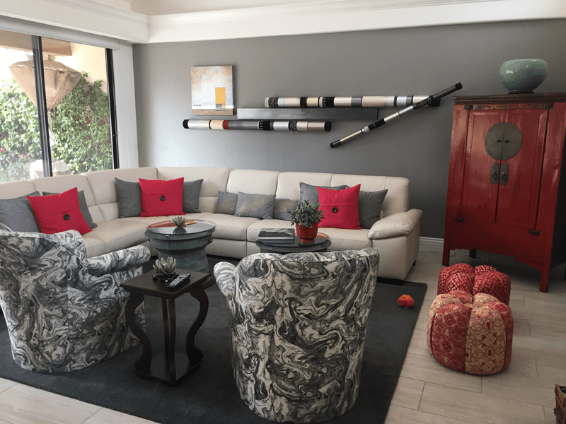 Gray Living room with darker gray accent wall.