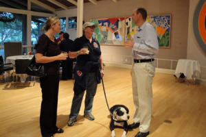 Megan Wenholz and Janet Wenholz of Operation Freedom Paws (our current nonprofit client) meet Dave Nielsen of ThinkResults Marketing for the first time in person. Clover (Janet's service dog) waits patiently.