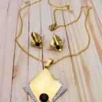 juego dorado resina zircones