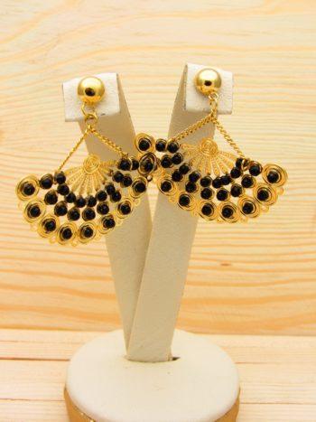 arete dorado cristales negro
