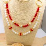 juego dorado perlas rojo cristales