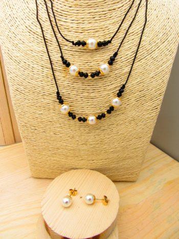 juego dorado perlas cristales negro cordon