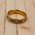 anillo dorado zircones colores