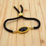 pulsera piedra negra dorada