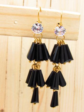 arete dorado cristales negro zircones