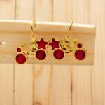 aretes dorado zircones rojo