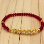 pulsera dorado cristales rojo