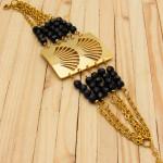 pulseras dorado cristales negro