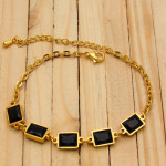 pulseras dorado zircones negro