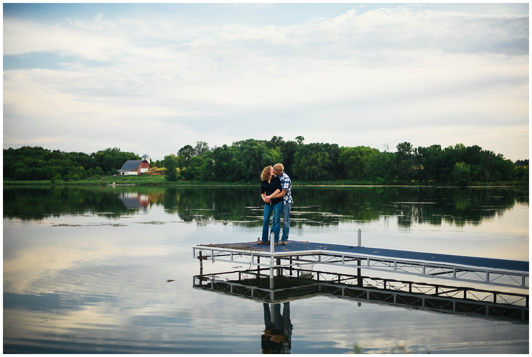 country couple kissing on dock