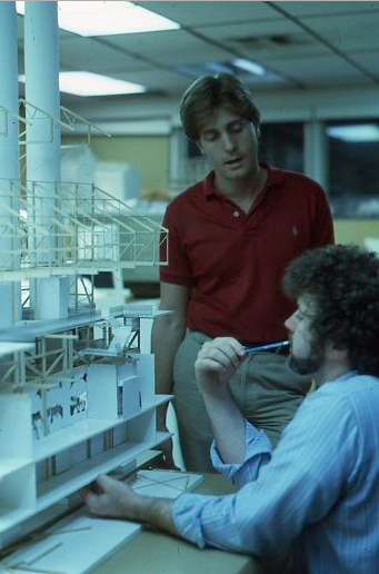 Ed Sotto and Gary Goddard discussing the show design around the first study model of the Power Plant main building Copyright The Goddard Group  All Rights Reserved