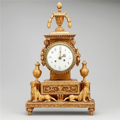 Mantle clock with Sphinxes.