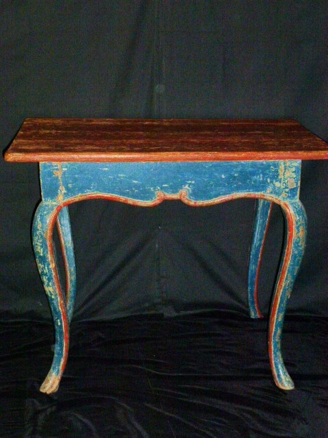 Swedish rococo table with original paint of orange trim and a blue body with a rustic top.