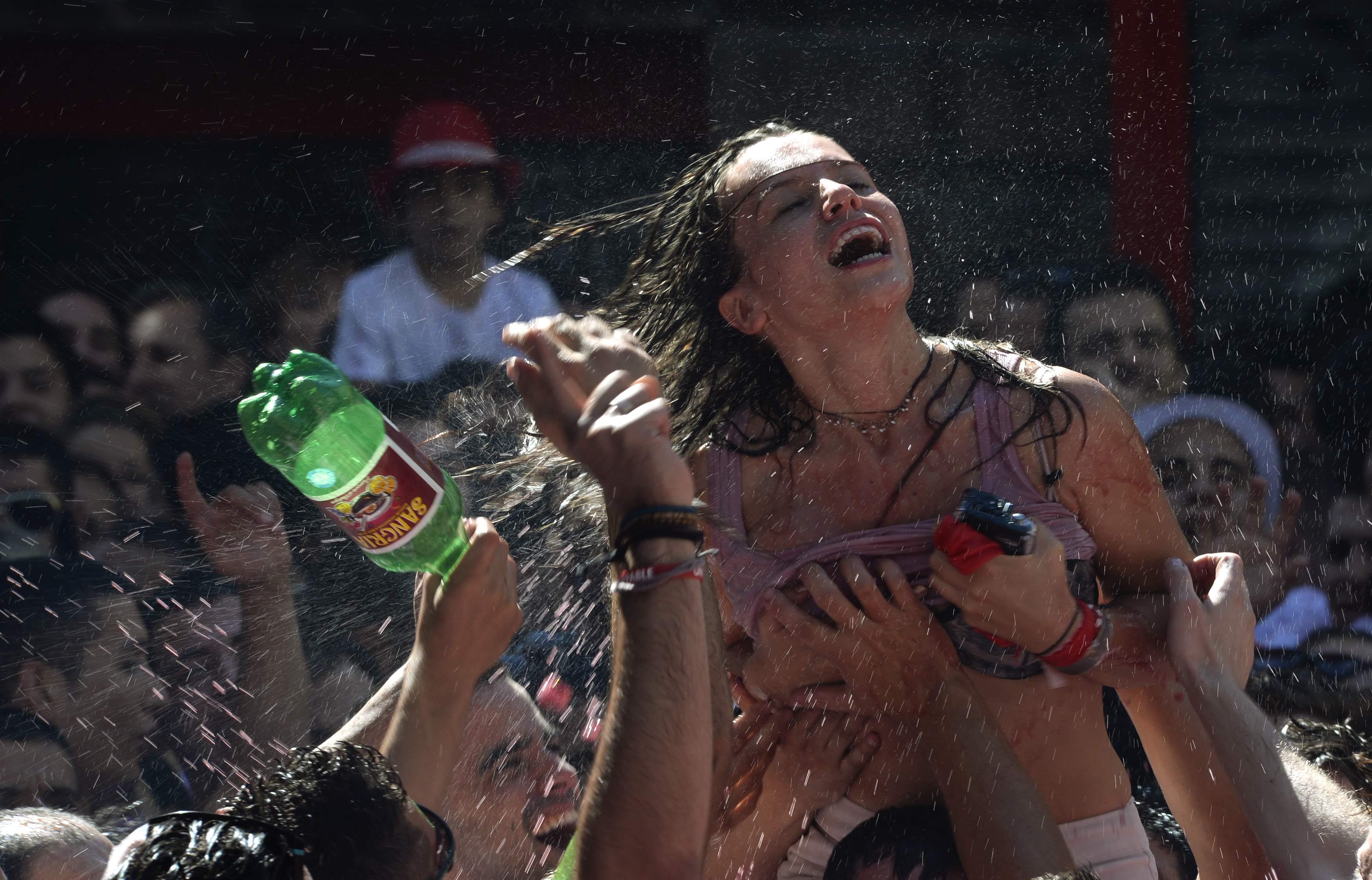 Revellers celebrate the start of the San Fermin festival in Pamplona