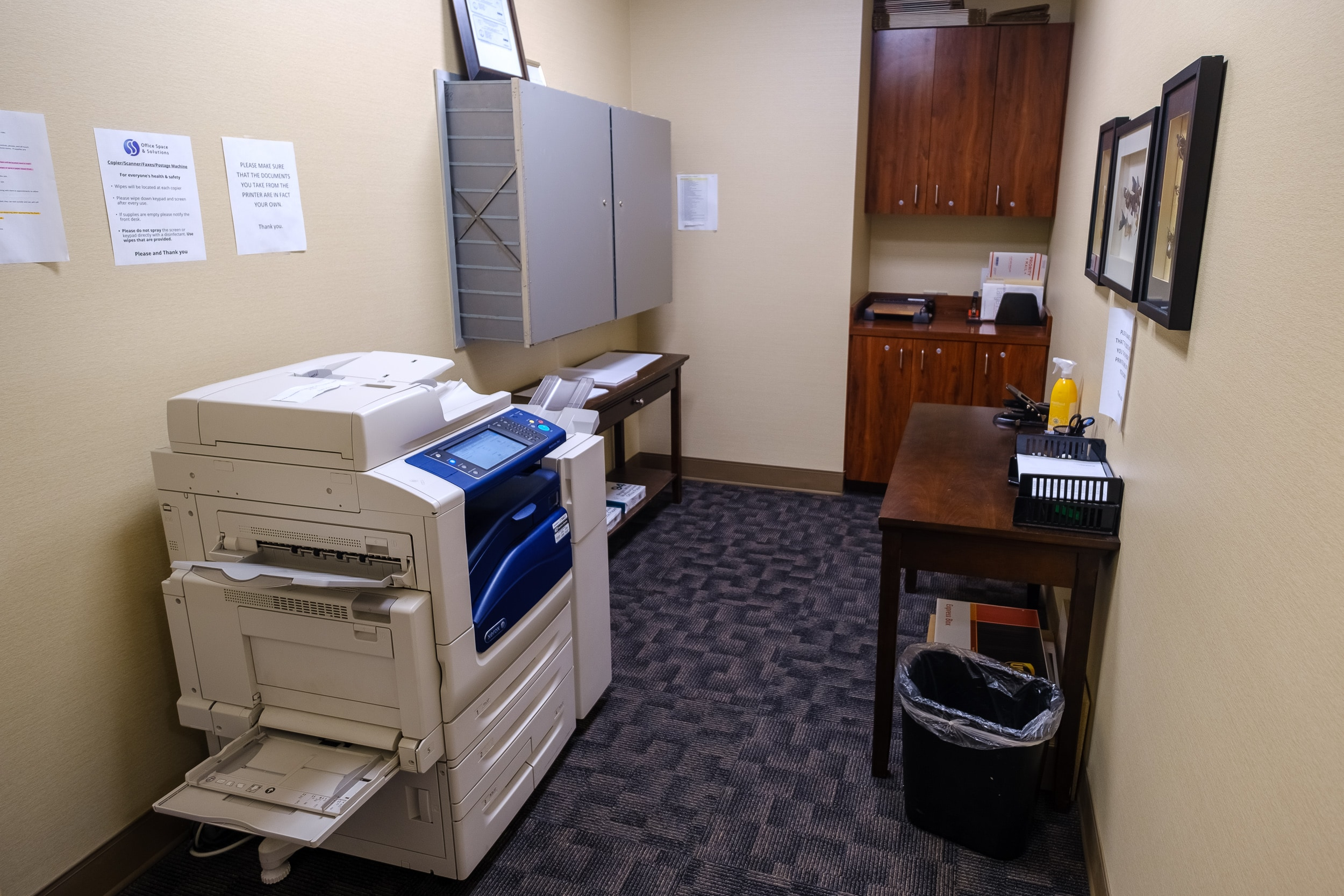 OSS Administrative Services Wells Fargo Center. Copying room with storage and various document processing stations, equipment and supplies.