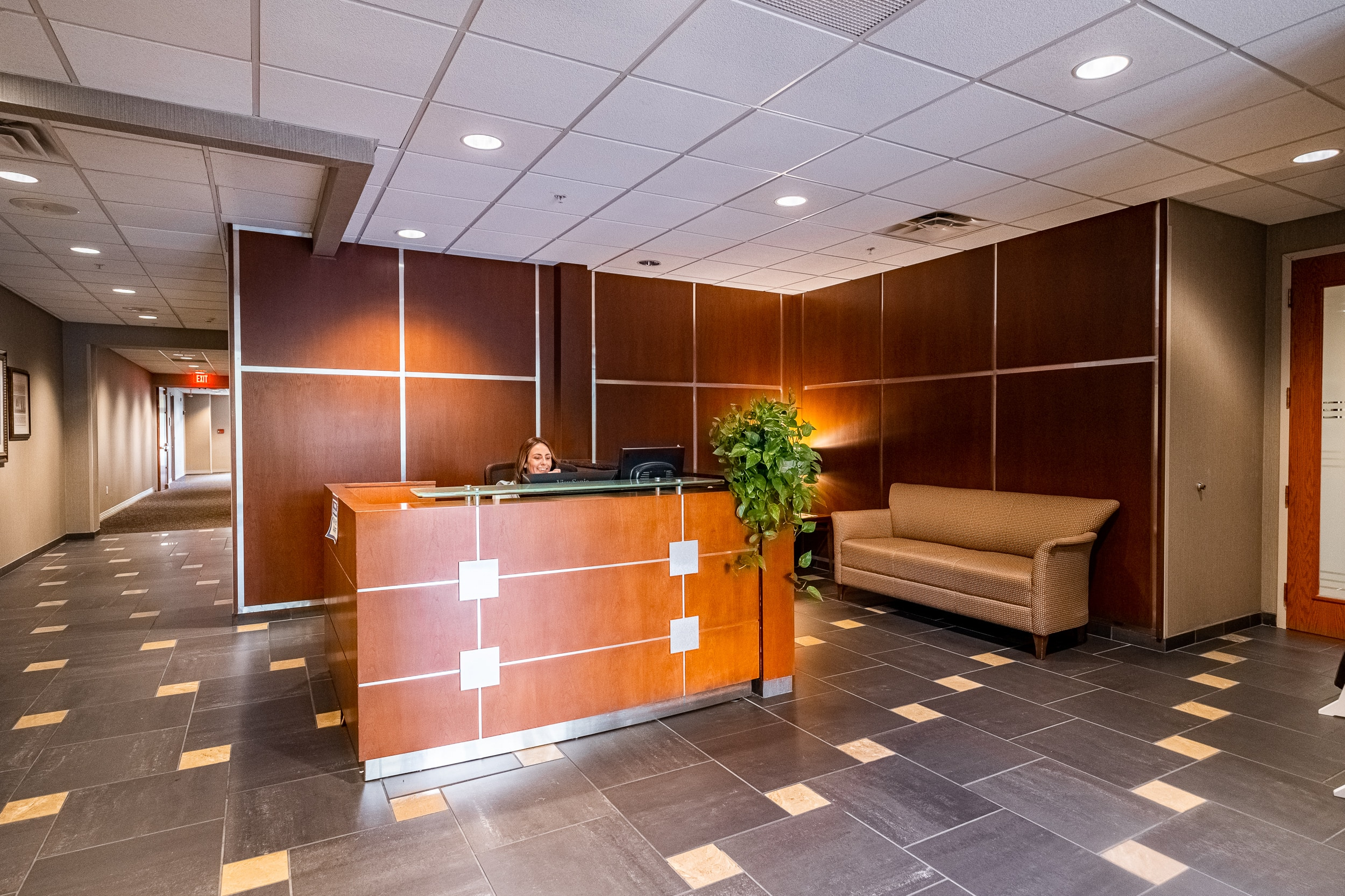 OSS Headquarters Lobby. Open and well-lit lobby, with stone floor and modern decor.