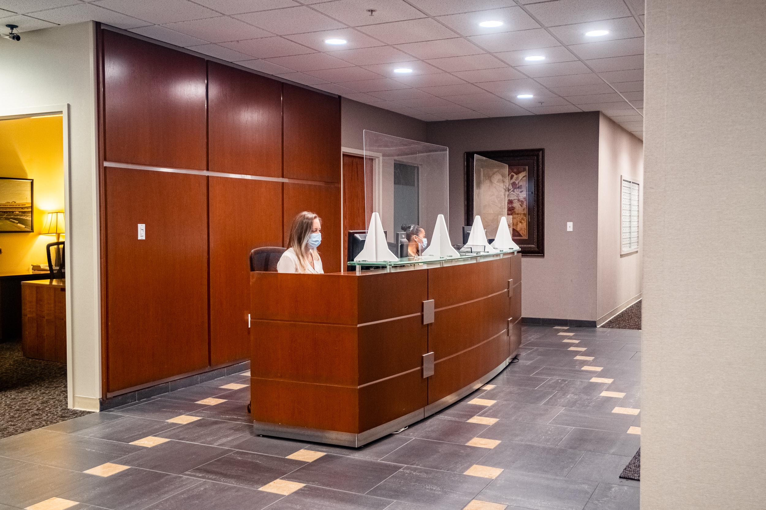 OSS Headquarters Virtual Receptionist. Receptionists greeting in the lobby of an office building.