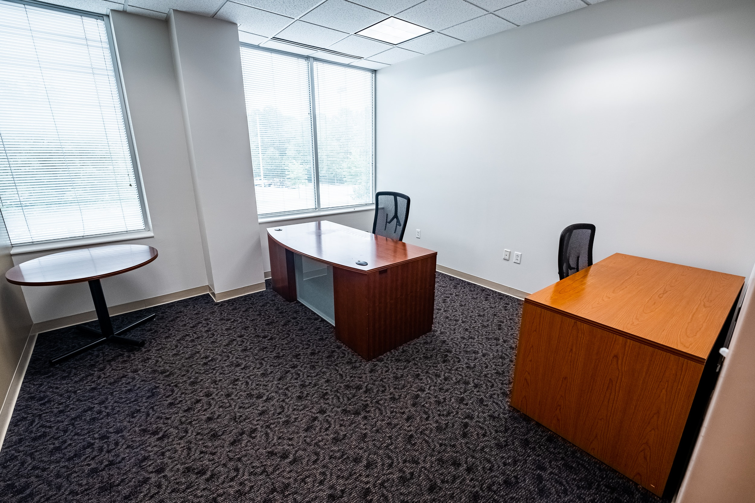 OSS Headquarters Virtual Office. Bright and roomy office with two desks and two large windows.