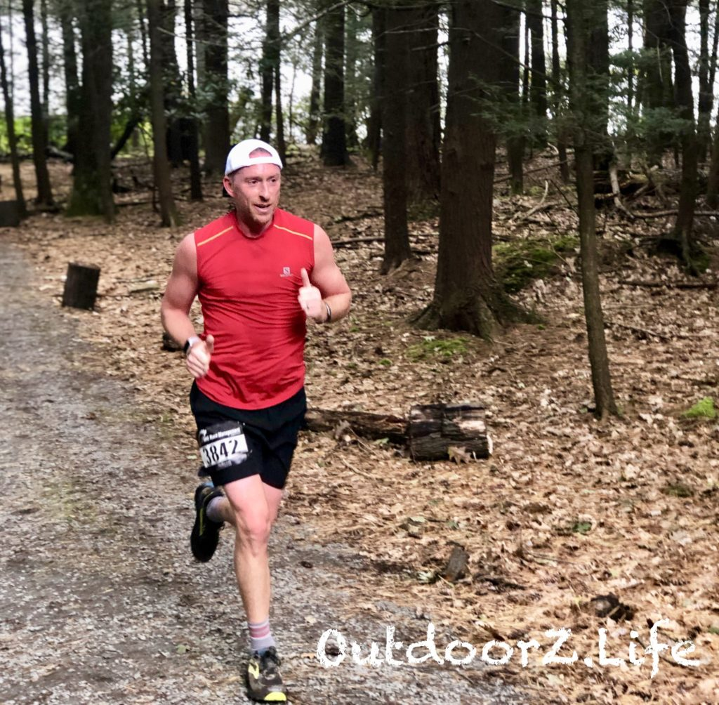 Picture of a runner in Lacawac's Lake to Lake 8K Trail Race