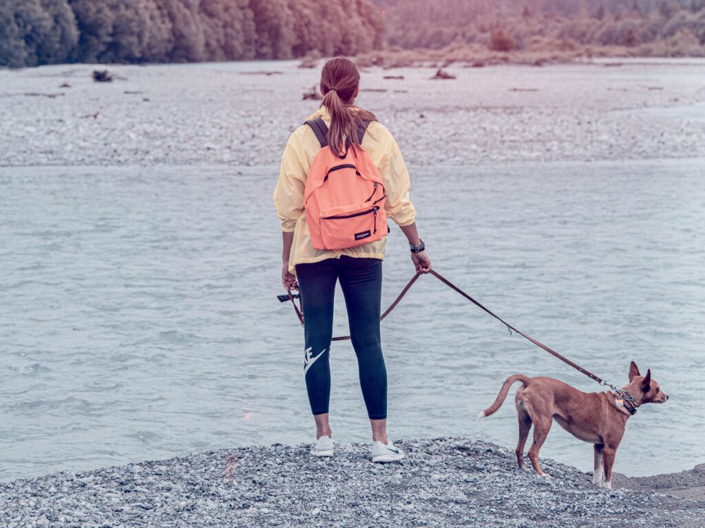 Woman hiking with her dog on a leash