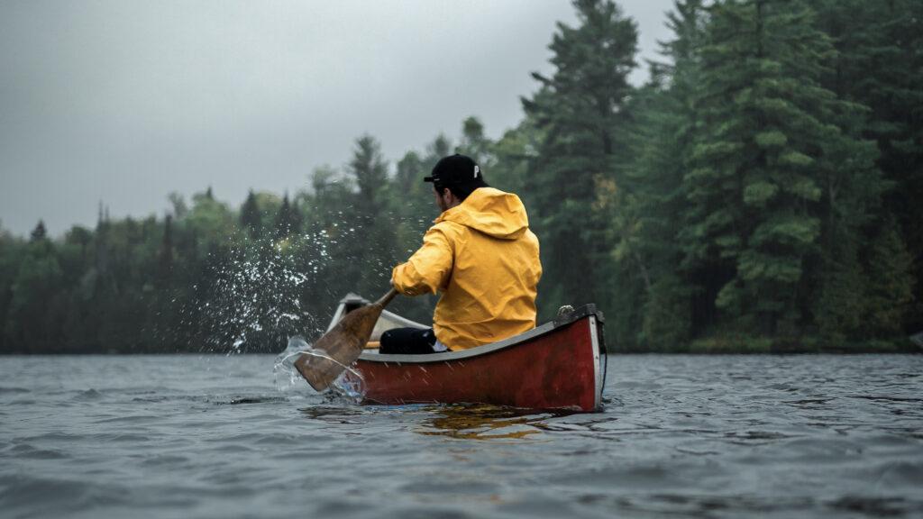 Man paddling a canoe