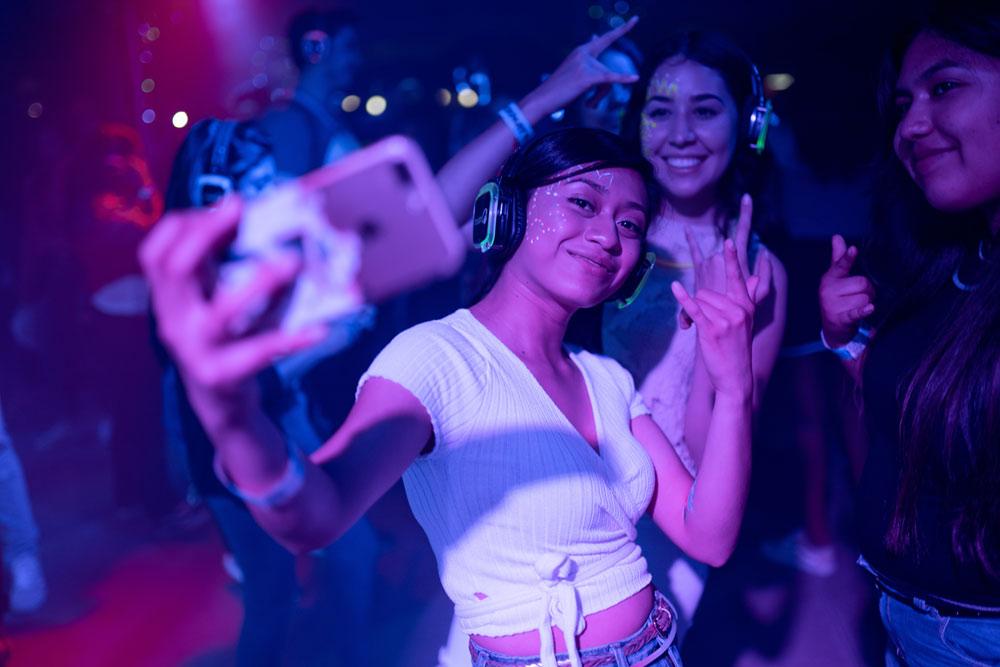 Ravers at a rave taking selfies