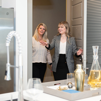 Leasing agent showing an apartment to a prospect