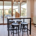 The dining nook, featuring a large sliding glass door leading to the covered patio.