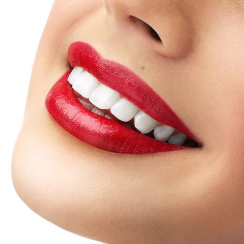 up-close smiling lady with lipstick after cosmetic work