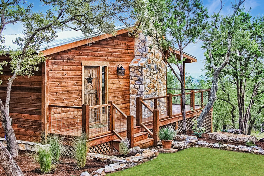 Property management done right with this fantastic log cabin overlooking the scenic Texas Hill Country.