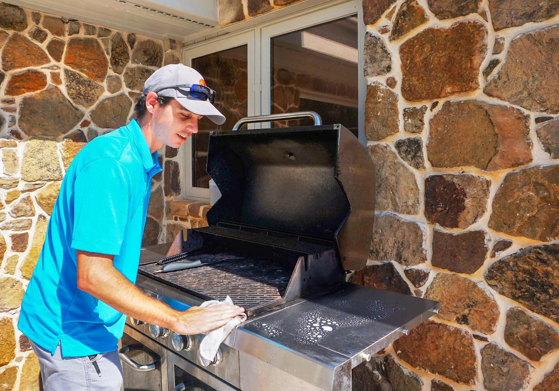 Property care- HCPL maintenance team cleaning a grill for check in