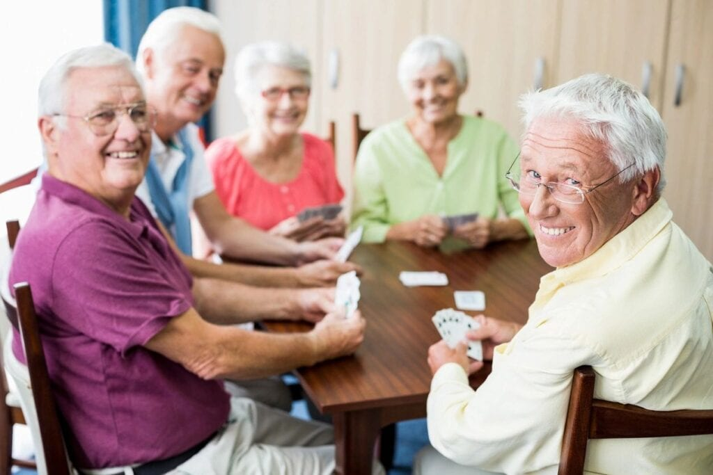 A group of elderly people playing cards