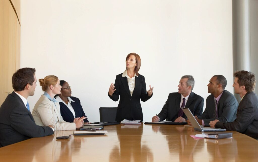 A woman talking in a business meeting