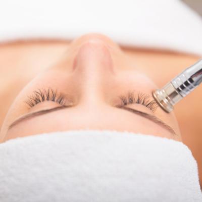 woman undergoing skin rejuvenation facial