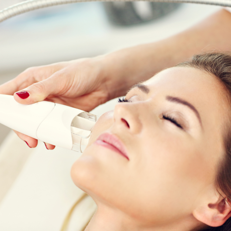 Woman's face getting BB Glow Treatment