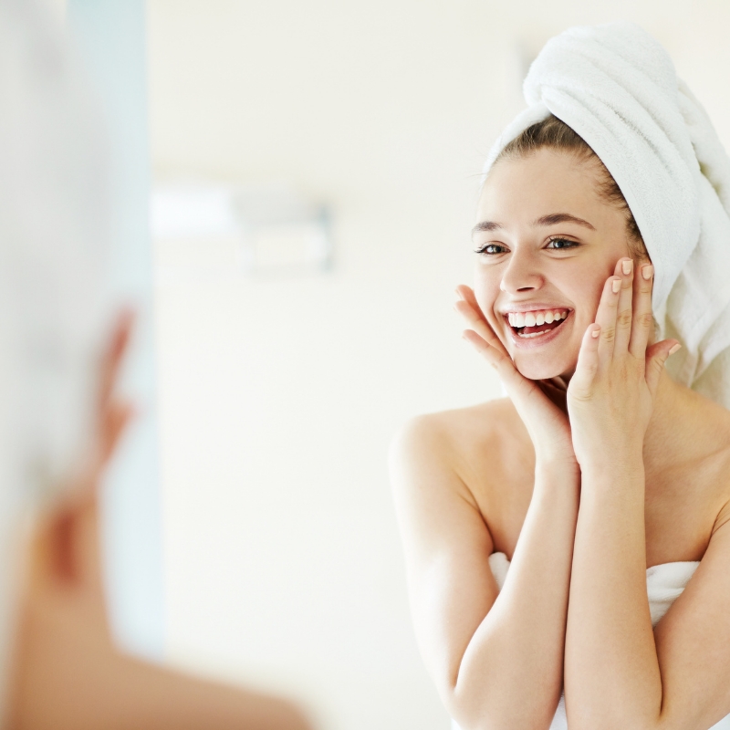Woman's smiling in mirror after