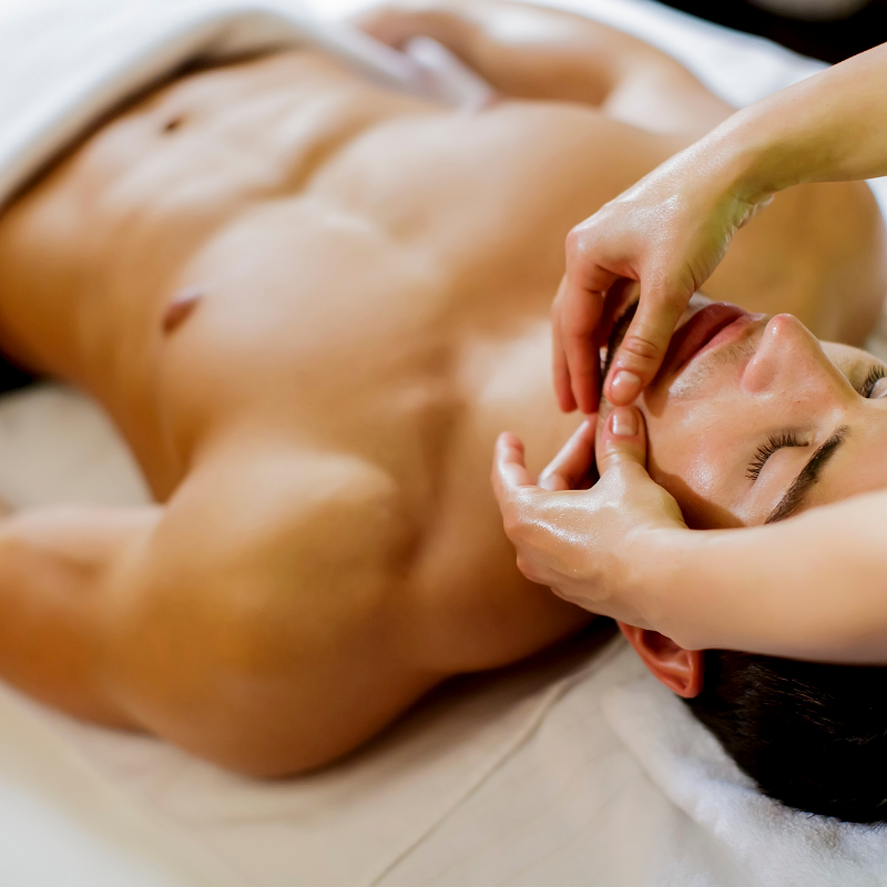 A man laying on table getting facial at Style and Beauty by Priscilla Medspa Dripping Springs