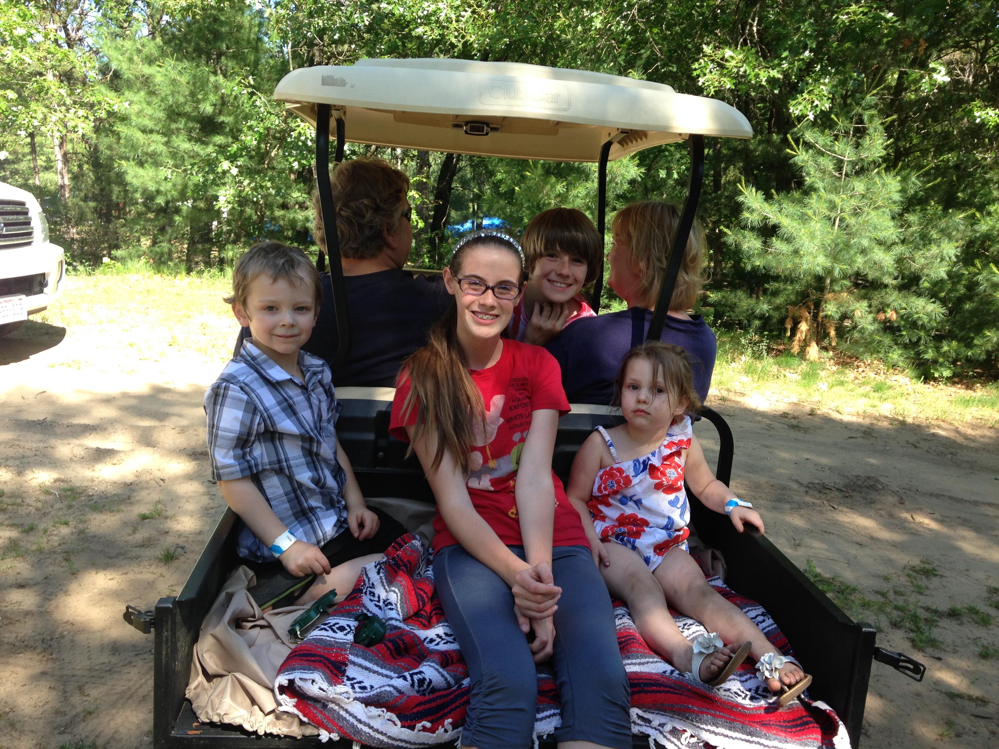 Kids on golf cart