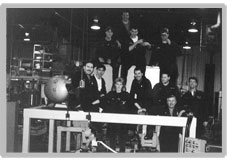 A picture of Machine Operators posed in a pyramid formation.