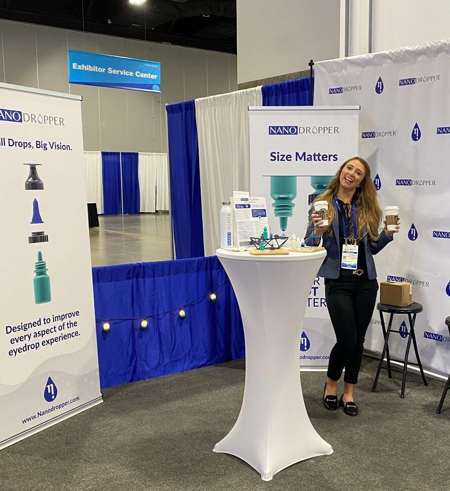 nanodropper co founder mackenzie andrews at the nanodropper booth at the american optometric association annual meeting in denver