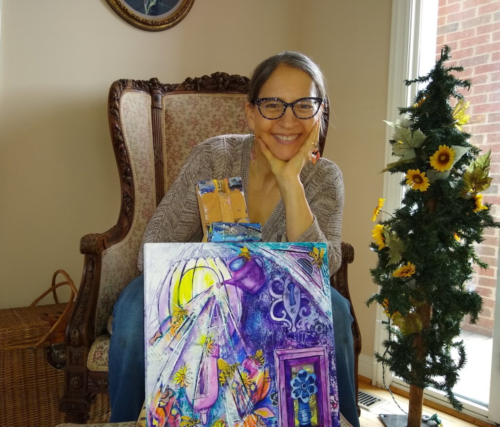 Alisa Clark with her latest mindfulness painting.