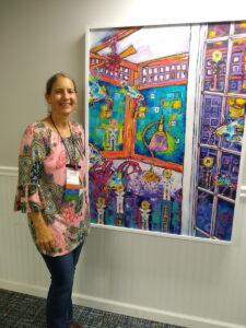 Photo of fine artist, Alisa E. Clark, at the 2021 ISEA Exhibit.