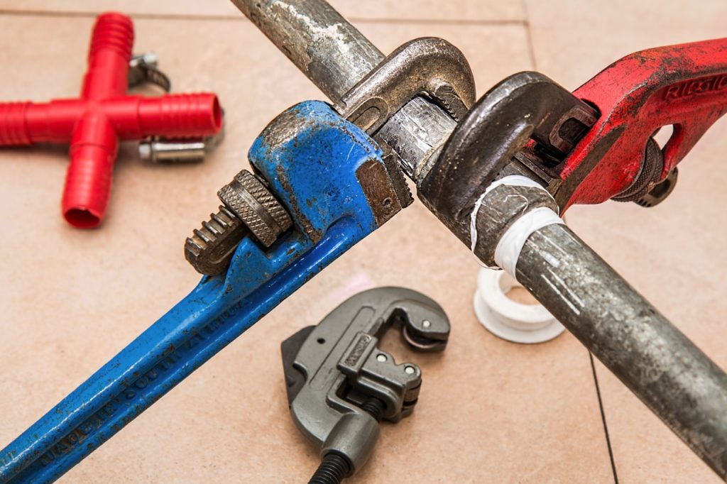 Wrenches around galvanized pipes