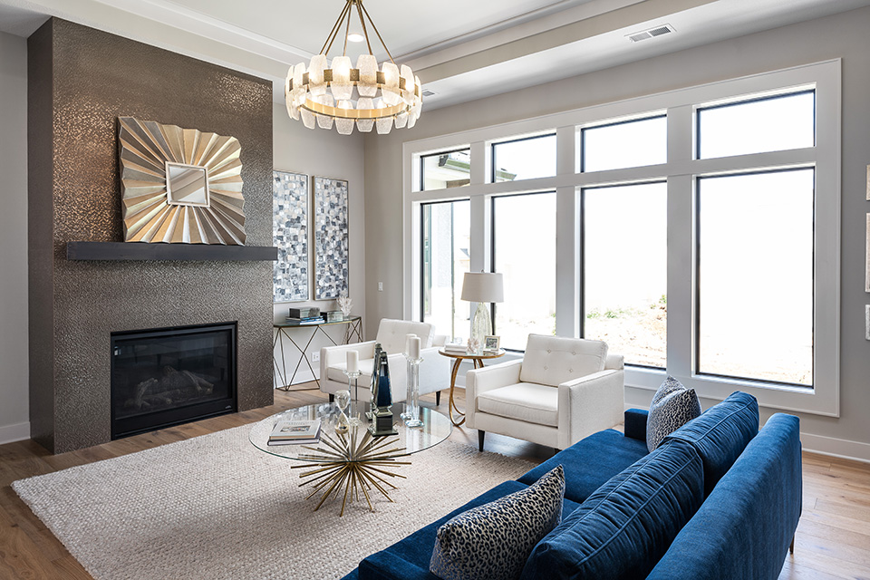 the del mar living room with floor to ceiling windows