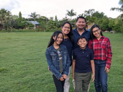 Mendez family in a field
