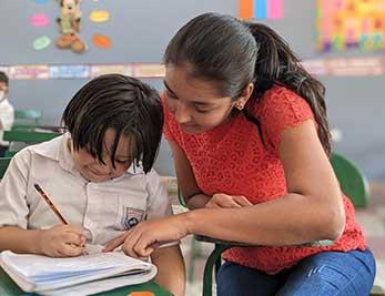 Teacher helping student with homework