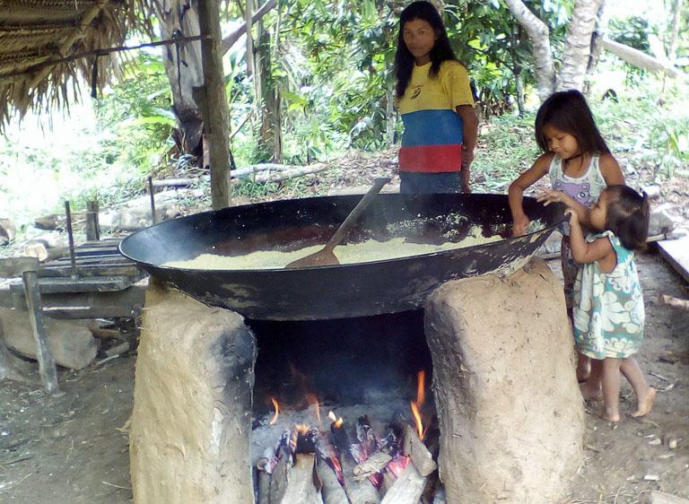 Roasting yuca to make farina