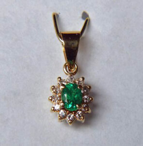 A fine example of a gold and diamond pendant